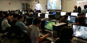 Large group of students playing videos games in a lab